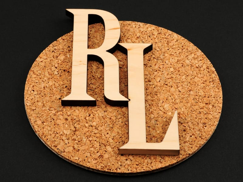 Laser Cut R and L Letters on Top of Corkboard