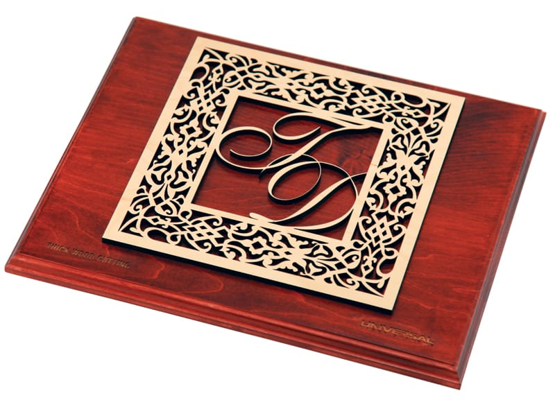 Laser Cut Light Color Plywood Design on Red Wood Plaque