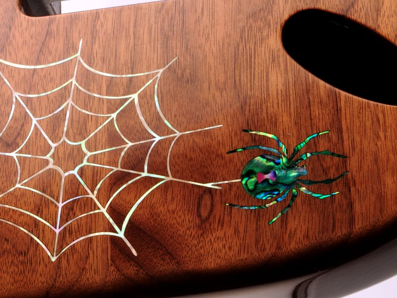 Laser Engraved Guitar Body with Laser Cut Mother of Pearl Spider Inlay Close Up