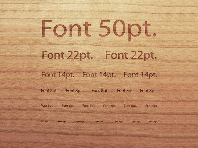 Laser Marked Decreasing Font Sizes on Cherry Wood