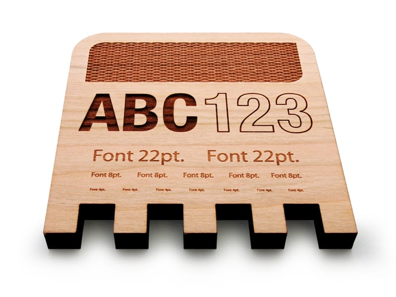 Laser Cut Marked and Engraved Design and Letters on Cherry Wood